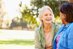 Two Senior Women Talking Outdoors Together stock photography