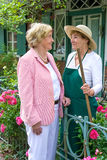 Two Senior Women Talking Together in Garden Stock Image