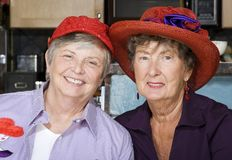 Two Senior Women Wearing Red Hats Royalty Free Stock Photo