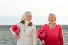 Senior women workout outdoor. Two senior women workout outdoor Stock Photography