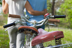 Two seniors with bicycles royalty free stock photos