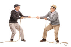 Two seniors competing in a tug of war Royalty Free Stock Photo