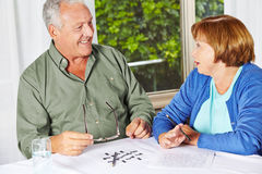 Two seniors doing memory training. With riddles in a rest home Royalty Free Stock Photography