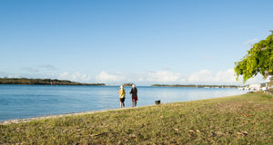 Two seniors fish on edge of Noosa River. Stock Image
