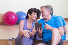 Two seniors having a chat at the gym Stock Images