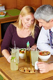 Two seniors having dinner Stock Images