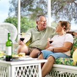 Two seniors having dinner on patio. Royalty Free Stock Photography