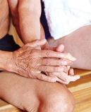 Two seniors holding hands in sauna Royalty Free Stock Photo
