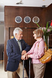 Two seniors at hotel reception Royalty Free Stock Image