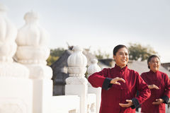 Two seniors practicing Taijiquan in Beijing, arms in a circle Stock Photos
