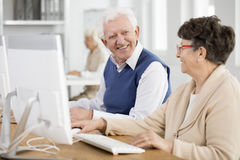 Seniors talking and smiling. Two seniors talking and smiling at the university of the third age Royalty Free Stock Photos