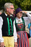Two seniors in traditional folk costume. A senior couple in traditional Swedish folk costumes at an event royalty free stock images