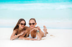 Two sensual women in bikini on a beach Stock Photos