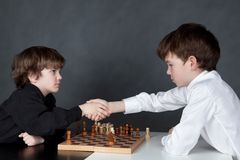 Two serious boy playing chess, studio Stock Images