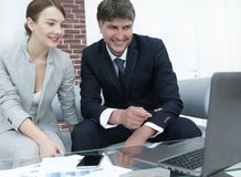Two serious business partners discussing financial report Stock Photo