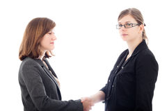 Two serious business women handshaking Royalty Free Stock Image