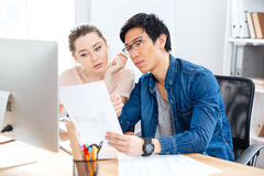 Two serious businesspeople working with documents in office Royalty Free Stock Photography