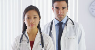 Two serious doctors looking at camera Royalty Free Stock Photos