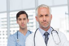 Two serious doctors standing Royalty Free Stock Photography