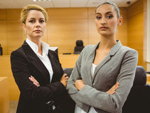 Two serious lawyers standing with arms crossed Stock Image