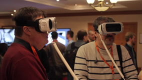 Two Serious Men in Virtual Reality. VR. Two men in virtual reality glasses are watching to the cyber world seriously stock video footage