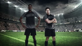 Two serious rugby players posing stock video
