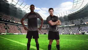 Two serious rugby players posing stock footage