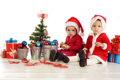 Two serious santa girls Stock Images