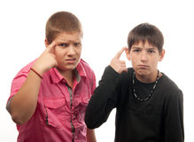 Two serious teenage boys posing Royalty Free Stock Images