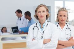 Two serious women doctors standing Stock Photo