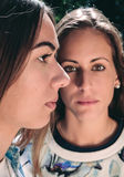 Two serious women with focus on profile woman Stock Image