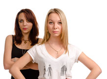Two serious youg female friends Royalty Free Stock Photography