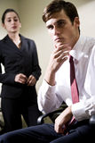 Two serious young businesspeople Stock Image