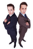 Two serious young men with arms crossed Royalty Free Stock Photo