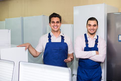 Two servicemen smiling at shop. Two armenian servicemen in blue uniform smiling at household appliances shop Stock Images