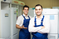 Two servicemen smiling at shop Stock Image