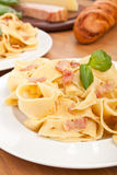 Two servings of homemade pasta carbonara stock photos