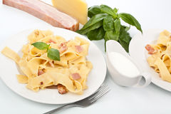 Two servings of homemade pasta carbonara Stock Images
