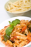 Two servings of penne pasta royalty free stock images