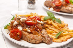 Two Servings of Pork Chops with Fries Stock Photo