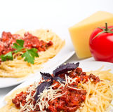 Two servings of spaghetti bolognese Royalty Free Stock Images