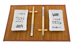 Two sets of dishes for sushi on the mat Stock Images
