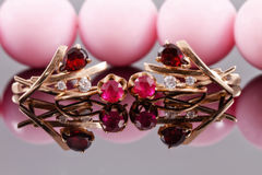 Two sets of gold earrings with rubies and alexandrites Stock Photo