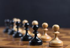 Two sets of pawn on chessboard. Selective focus Stock Photo