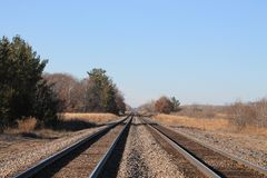 Two sets of railroad tracks on a nice fall day stock photography