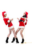 Two sexual girls in Christmas clothes Stock Images