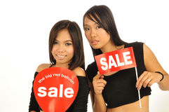 Two sexy Asian females showing on sale signs Stock Image