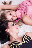 Two sexy beautiful women lying Royalty Free Stock Photos