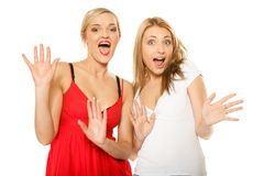 Two sexy crazy women in summer clothes. Royalty Free Stock Image