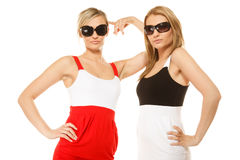 Two sexy crazy women in summer clothes sunglasses. Stock Image